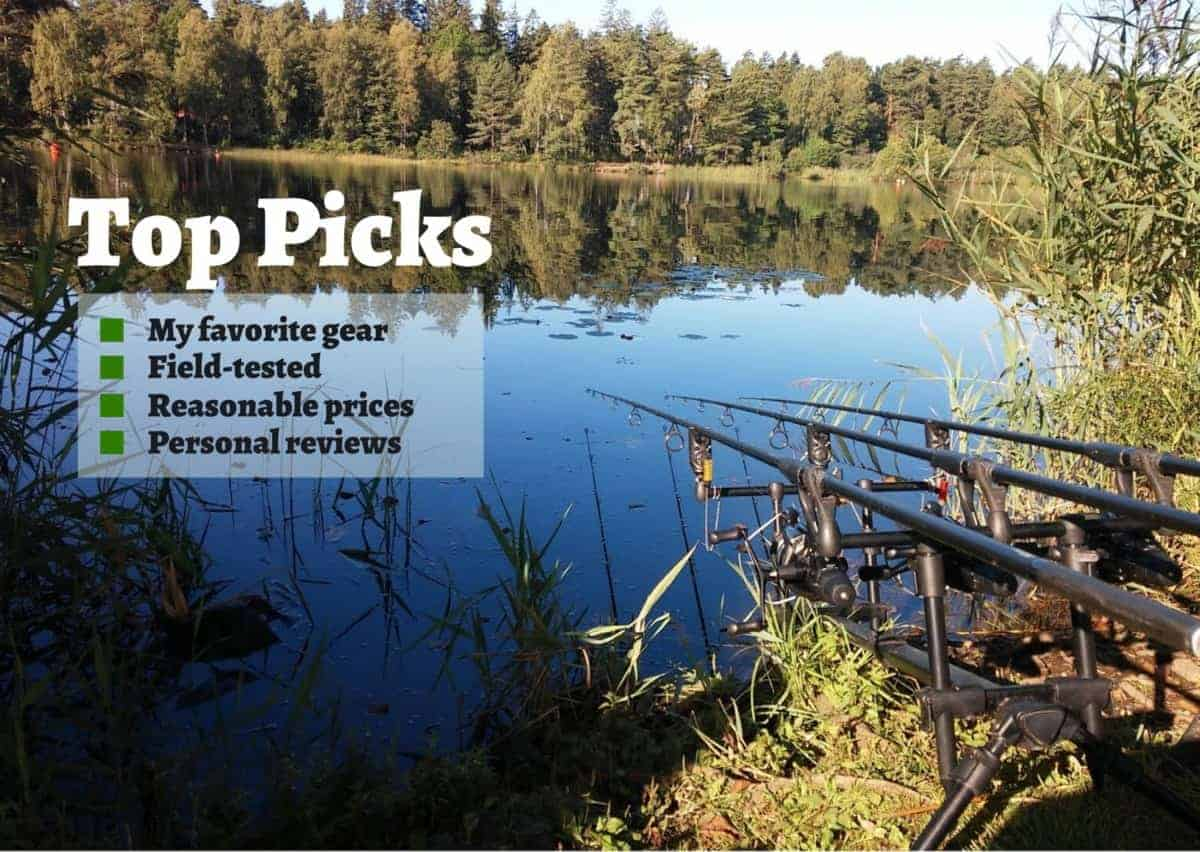 a beautiful image of a carp lake in the morning and a rod pod with 3 rigged carp rods on it waiting for a carp run