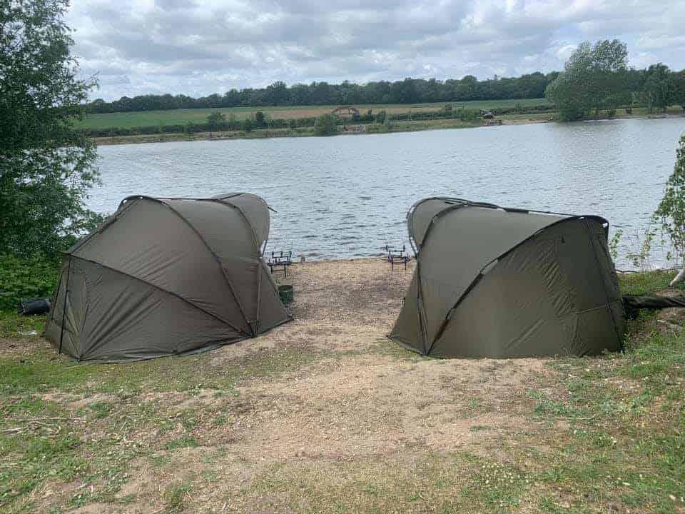 2 bivvies close to a carp lake