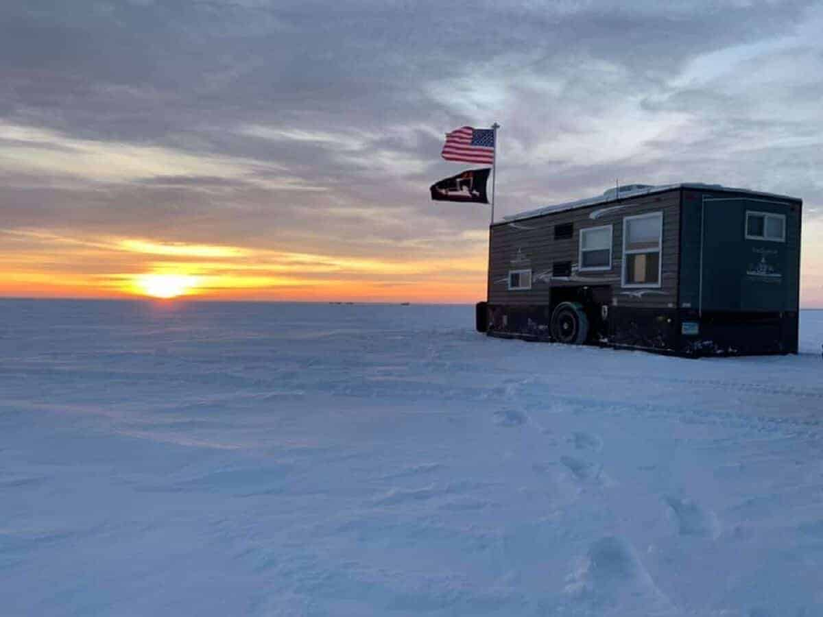 a picture of an ice fishing shack on a frozen Minnesota lake