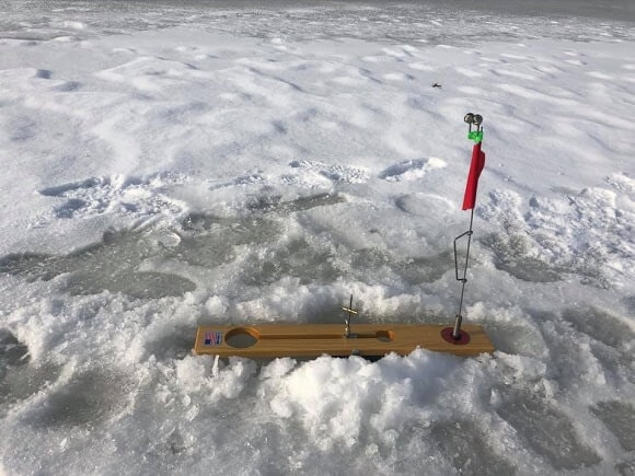 a rigged tip up for northern pike