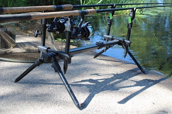 a pair of specialist rods and shimano baitrunners on a rod pod with bite alarms and hangers waiting for a tench bite