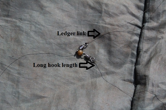 a running rig with two small swivels and a buffer bead for perch