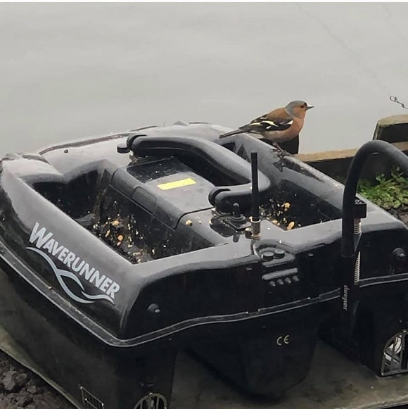 an empty bait boat on a carp venue