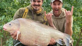 two American anglers with a giant buffalo fish caught on a lake in Texas