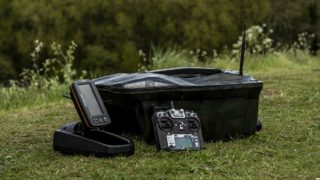 a bait boat for carp fishing with a remote and a fish finder