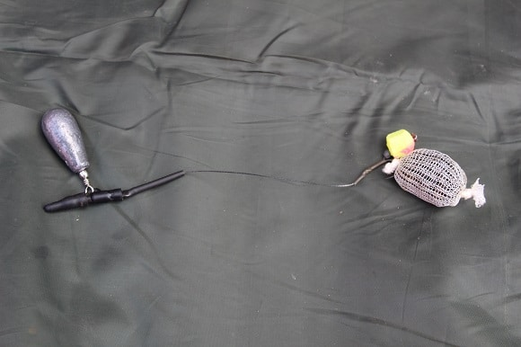 a bolt rig with a scaled-down pop-up and a pva nugget ready to catch tench