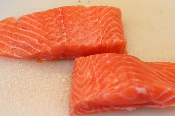 an image of two fresh and red salmon fillets