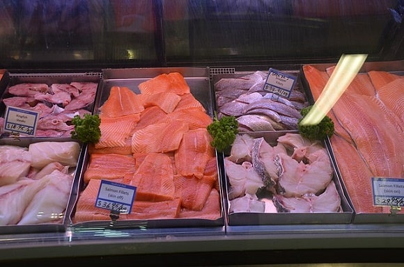 an image of different fish fillets being displayed on a fish market