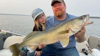 An angler and his daughter fishing for walleye on lake Saskatchewan