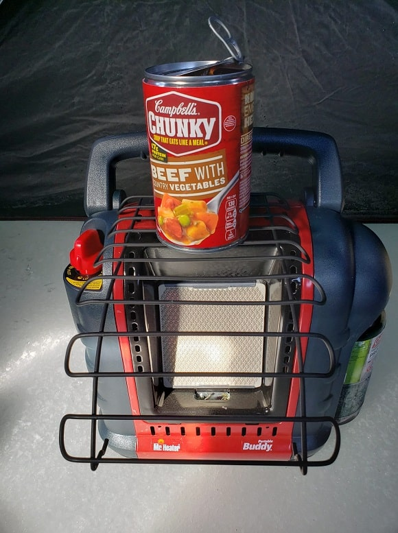 a mr heater portable buddy used as a portable grill to cook food on
