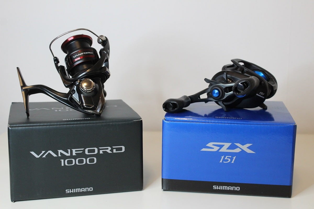 an image of two new shimano reels on a white table